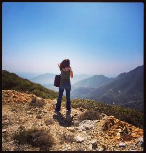 Here I am taking in the gorgeous view near the tiny Eleousa church, located in my family's village of Othos, Karpathos.