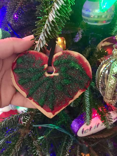 Anna's ornament from 2013... a gingerbread cookie from IKEA that had been decorated with tons of icing and sugar (polyurethaned)